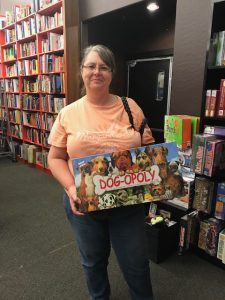 Customer buying Dog-opoly board game