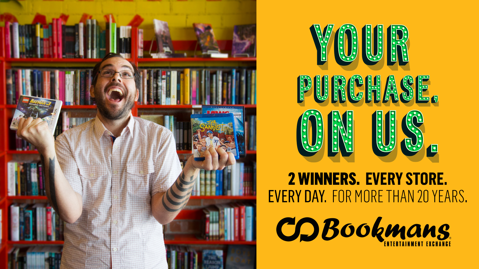 Excited man winning free video games and movies at Bookmans