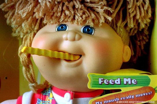 Snacktime Cabbage Patch Kid doll eating a fake french fry