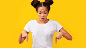 adobe stock image woman pointing down pigtails