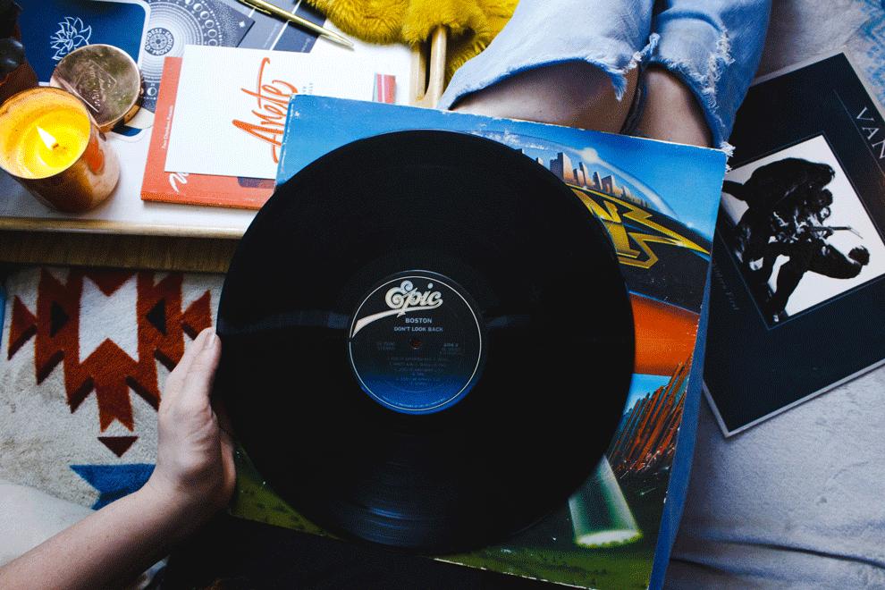 woman holding vinyl record