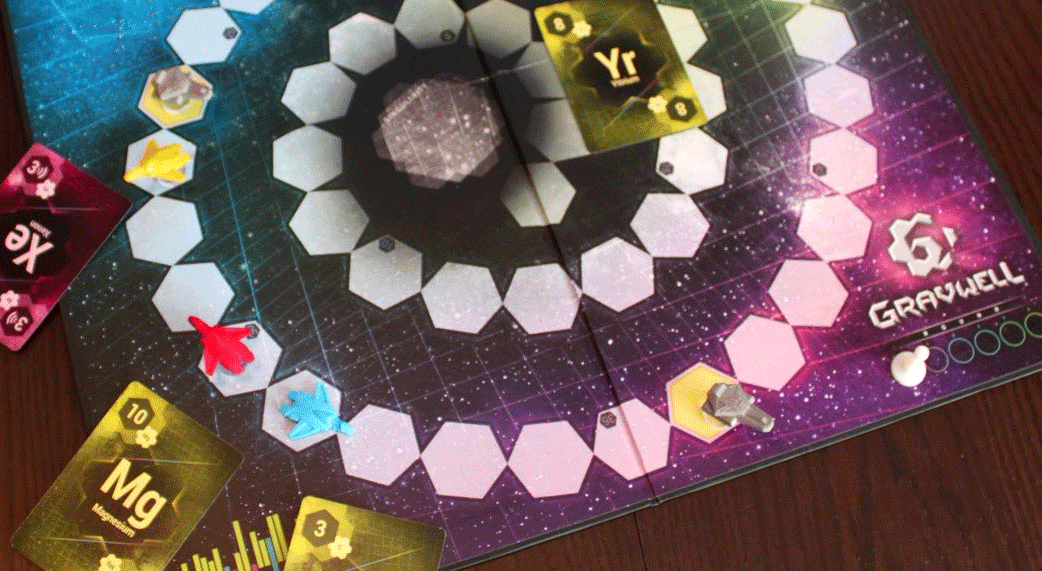 Gravwell board game board with yellow cards and spaceship figures