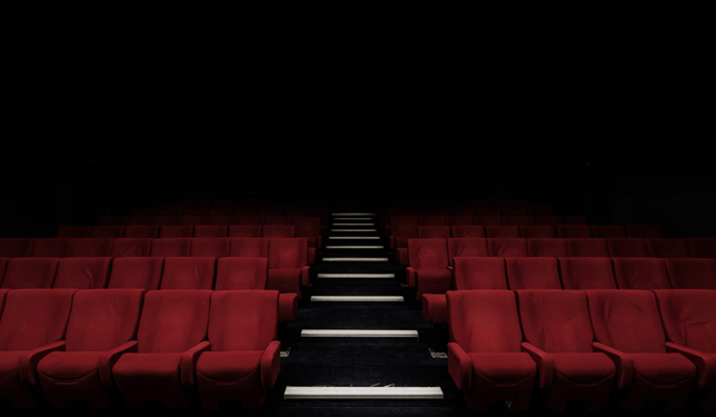 Red theater seats in a dark theater