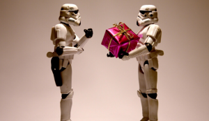Star Wars storm troopers giving a red gift box